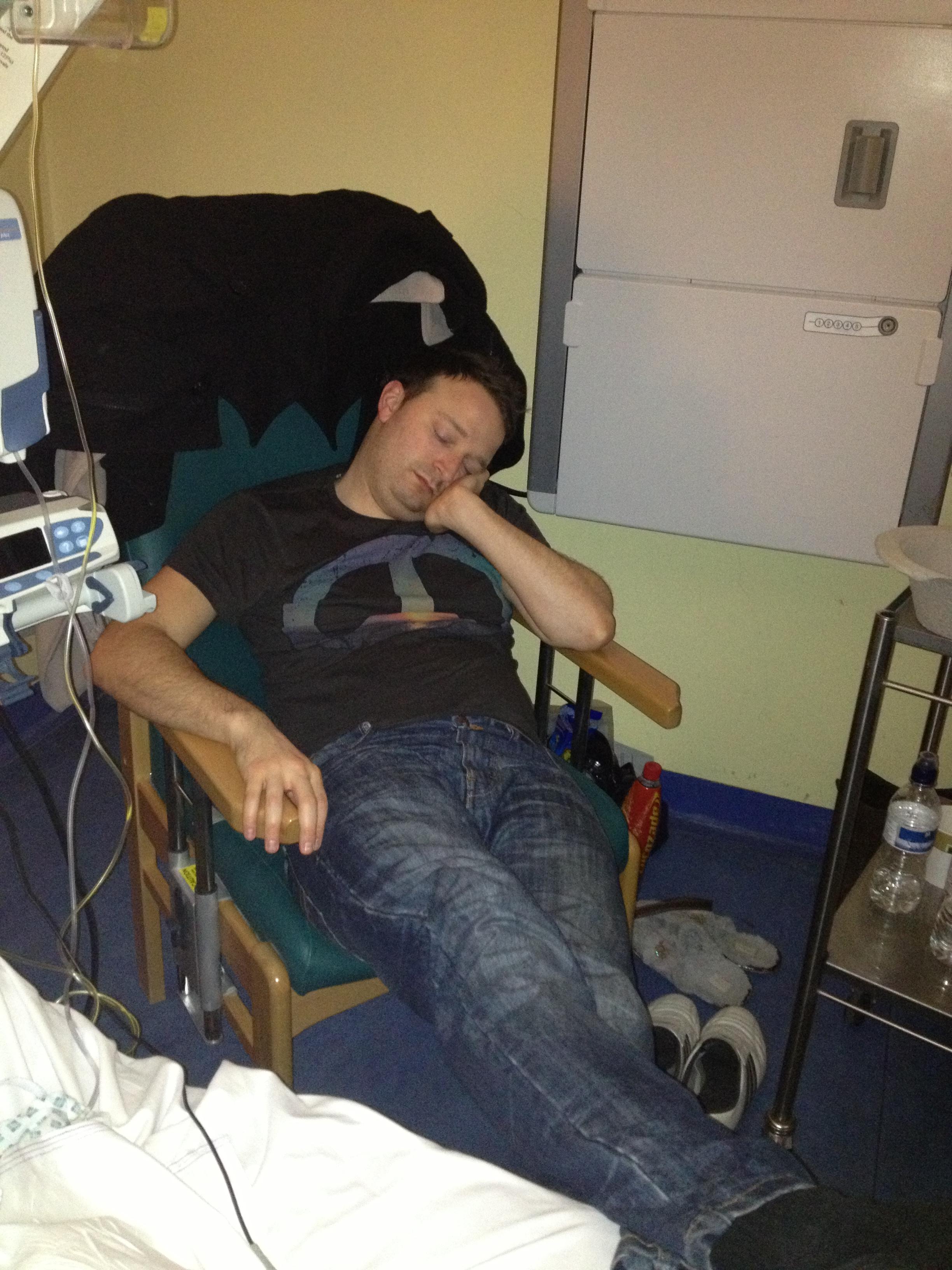 man asleep in hospital