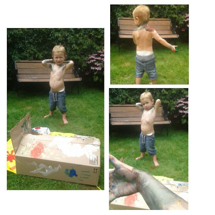 child covered in paint in the garden