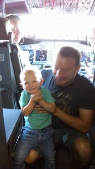 toddler and son in the cockpit of the plane