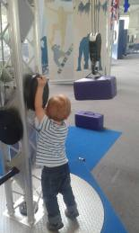 child using equipment in the science museum
