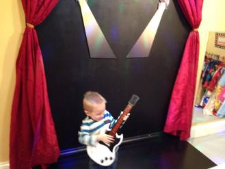 child playing toy guitar