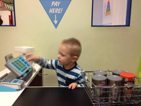 child playing with cash register
