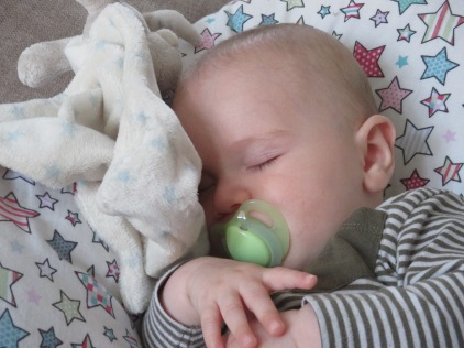 baby asleep on nursing pillow