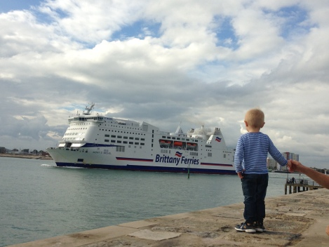 child looking out to a ferry