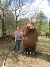 Mum and child stood next to the gruffalo