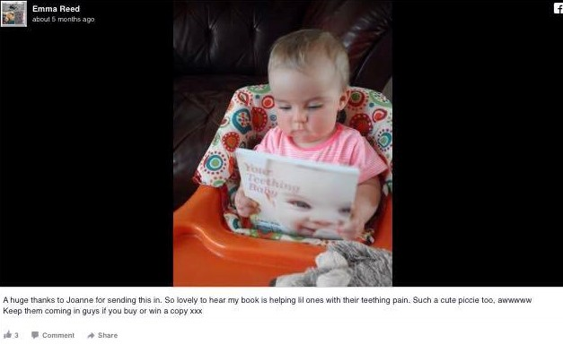 baby reading teething book
