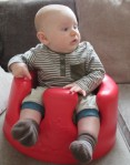 baby in a bumbo