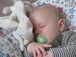 baby asleep on nursing pillow