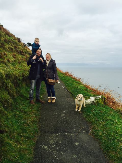 family on a walk with dog
