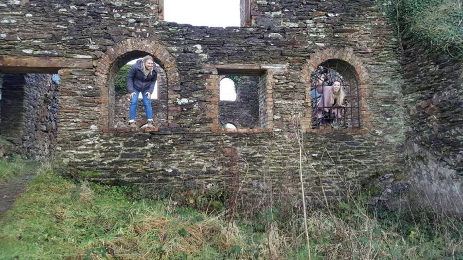 sisters in the windows of ruins