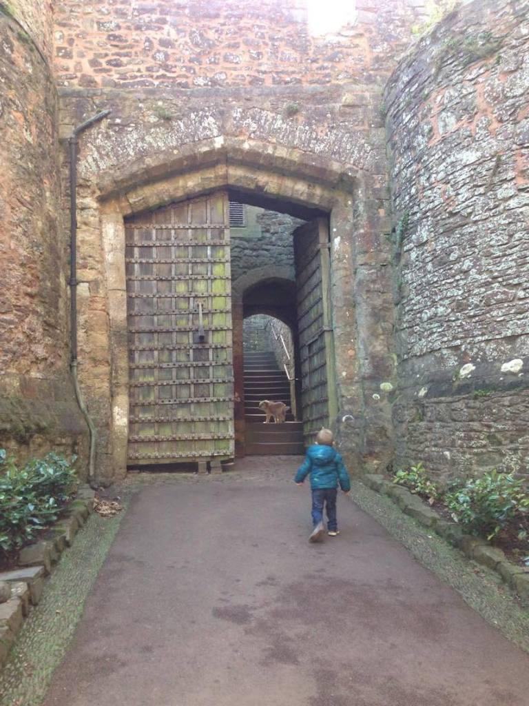 child walking through castle door